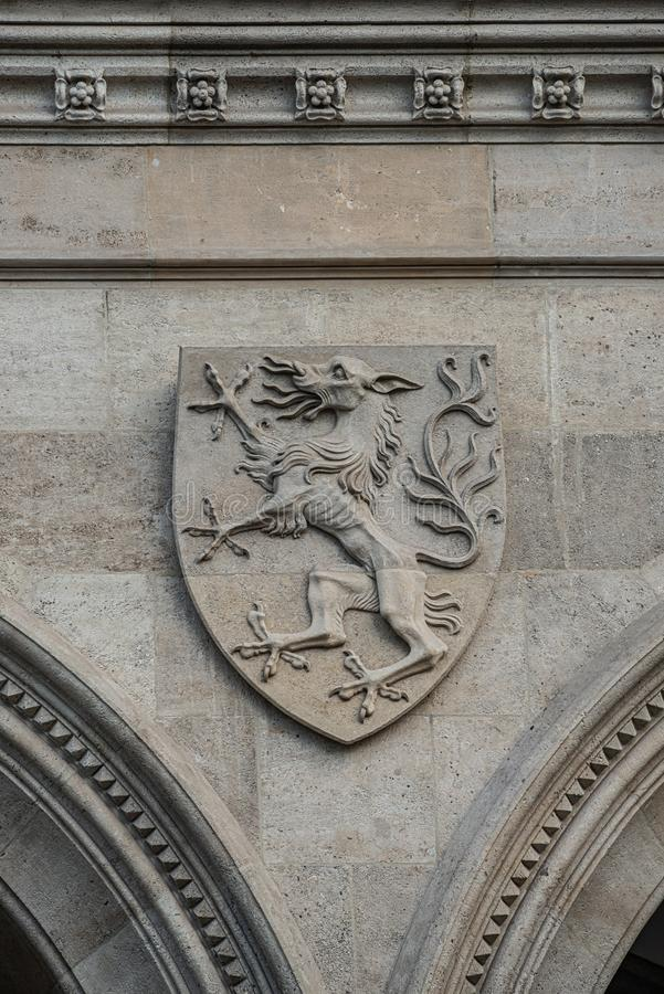 Heraldic Coat of Arms as decoration elements at facade of main city hall Rathaus in Vienna, Austria. Closeup, details stock images