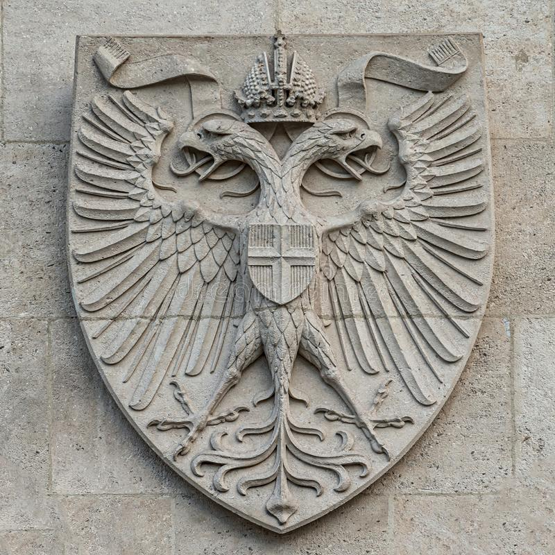 Heraldic Coat of Arms as decoration elements at facade of main city hall Rathaus in Vienna, Austria. Closeup, details stock image