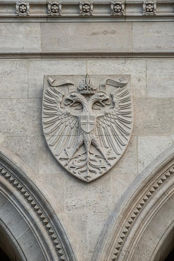 Heraldic Coat of Arms as decoration elements at facade of main city hall Rathaus in Vienna, Austria. Closeup, details stock photo