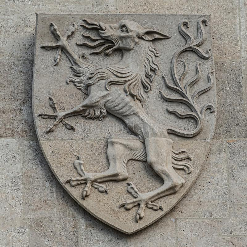 Heraldic Coat of Arms as decoration elements at facade of main city hall Rathaus in Vienna, Austria. Closeup, details stock photos