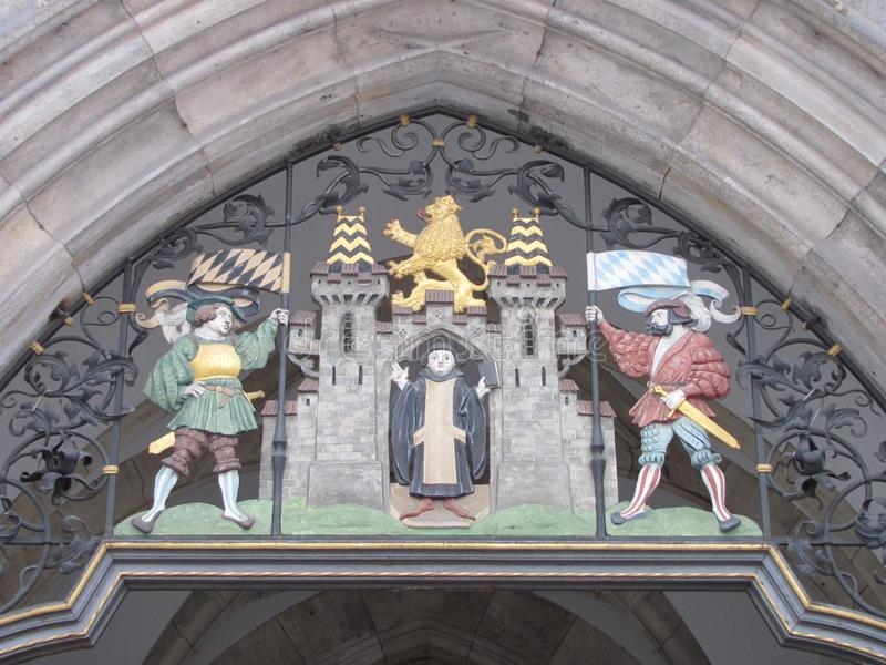 Munich heraldic crest. The heraldic crest for the city of Munich Germany above a doorway into the Ratskeller stock photos