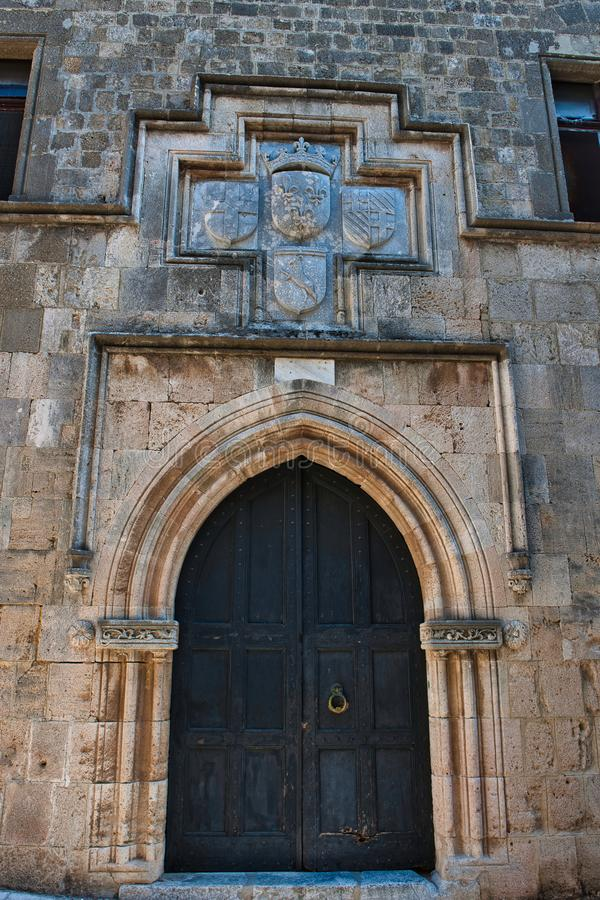 Heraldic Emblem over a door onthe Avenue of the Knights. Avenue of the nights is the only residential late medieval street in Europe which remains in tact.it royalty free stock photography