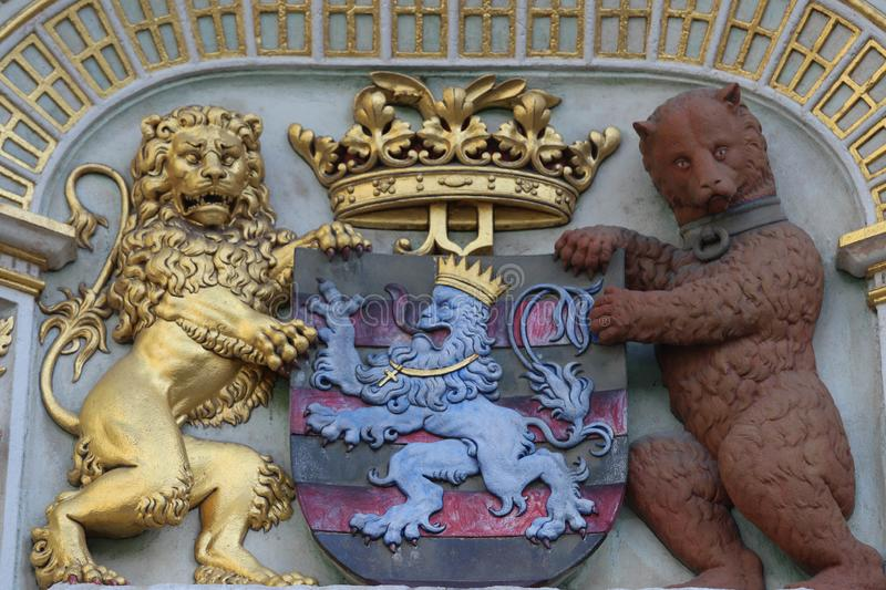 Heraldic lion and bear, town hall Coat of arms , the city arm of Bruges, Belgium, Europe. BRUGES, BELGIUM - May 29 , 2019 : Heraldic lion and bear, town hall royalty free stock images