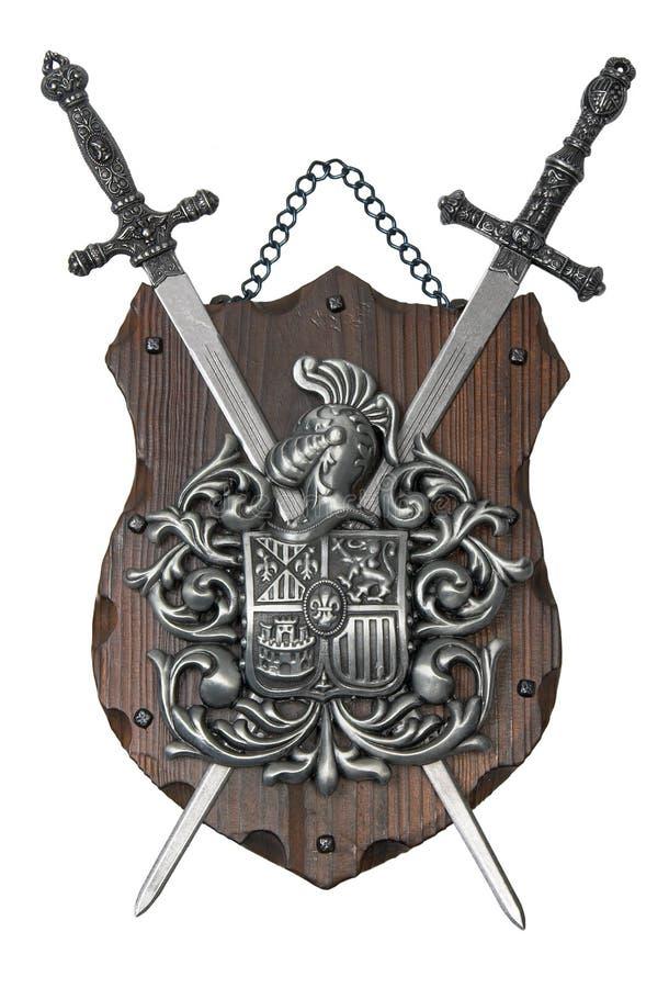 Heraldic shield 2. Souvenir heraldic shield and two swords royalty free stock photos