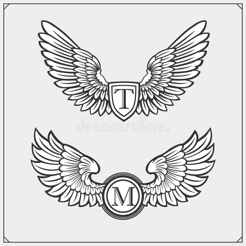 Heraldische Flügel eingestellt Vier Schneeflocken auf weißem Hintergrund Auch im corel abgehobenen Betrag lizenzfreie abbildung