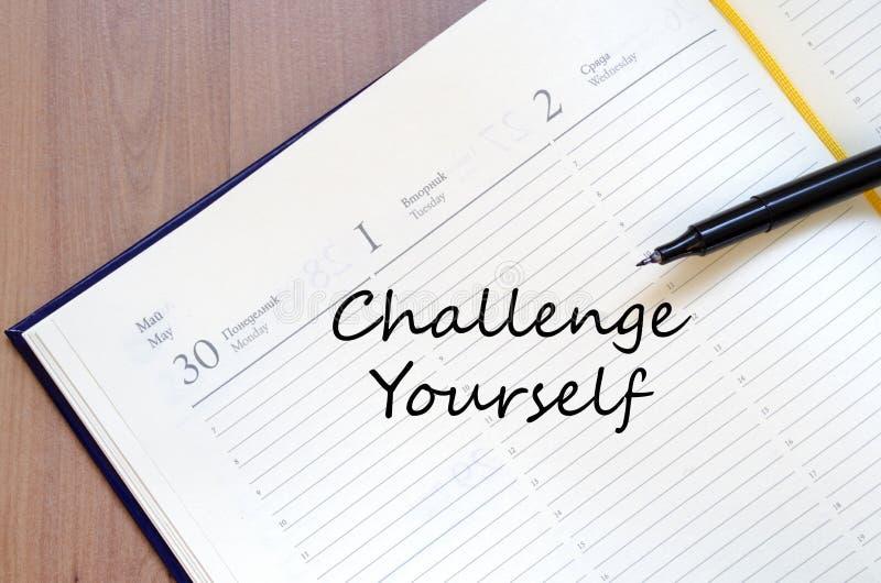 Herausforderung sich schreiben auf Notizbuch lizenzfreies stockfoto