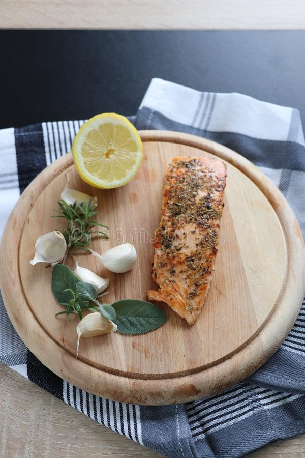 Herb baked salmon fillet with seeds stock images