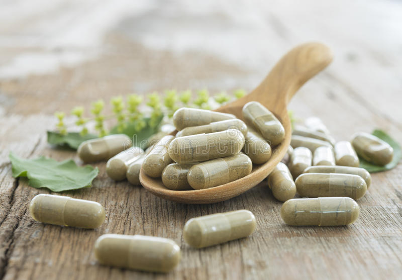 Herb capsule. Nutritional Supplement, Vitamin Pill, Herbal Medicine royalty free stock photo