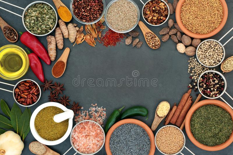 Herb and Spice Abstract Border. Herb and spice abstract background border with dried herbs and spices on slate. Top view stock image