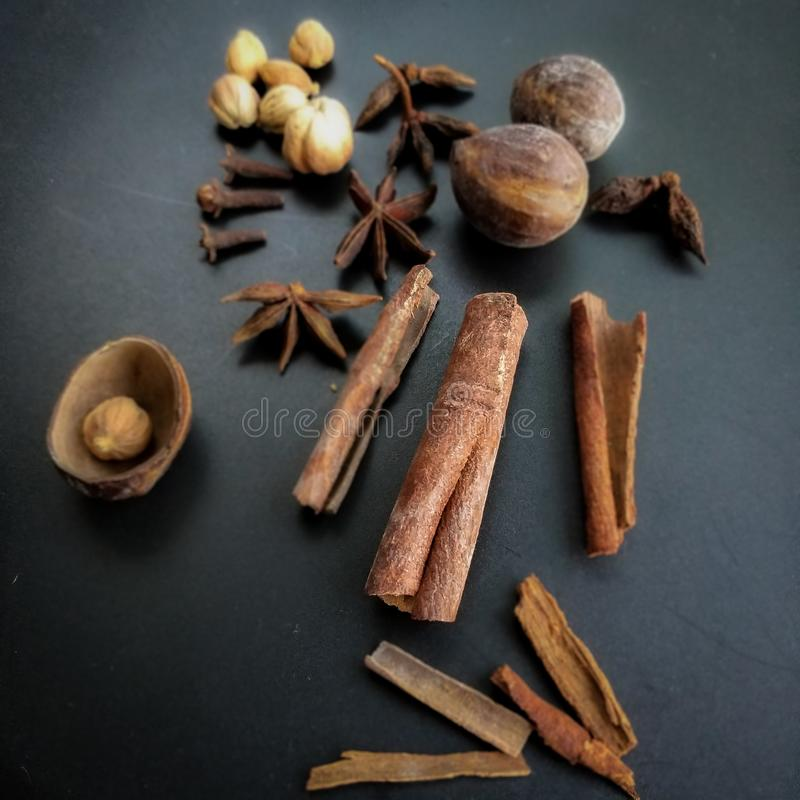 Herb and spice, ingredient of cinnamon and cardamom indonesian and india food . royalty free stock image