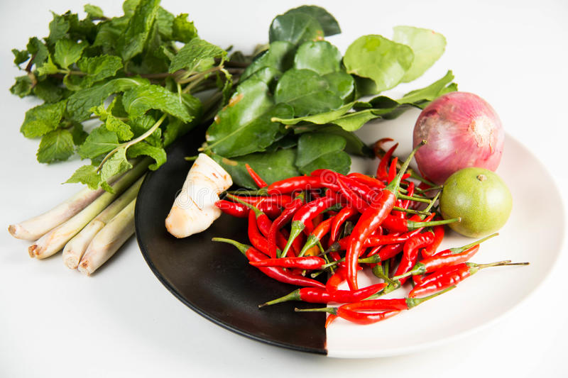 Herb and spicy ingredients for making Thai food. Kaffir lime leaf, lemon, lemongrass, galangal, chili, onions, herb and spicy ingredients for making Thai food royalty free stock photo