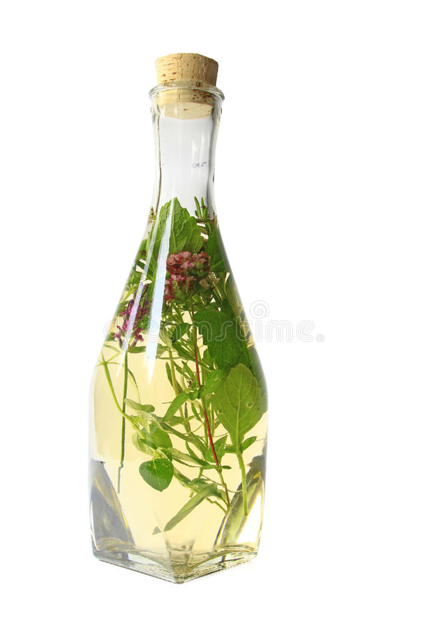 Herb vinegar. With various herbs stock photo