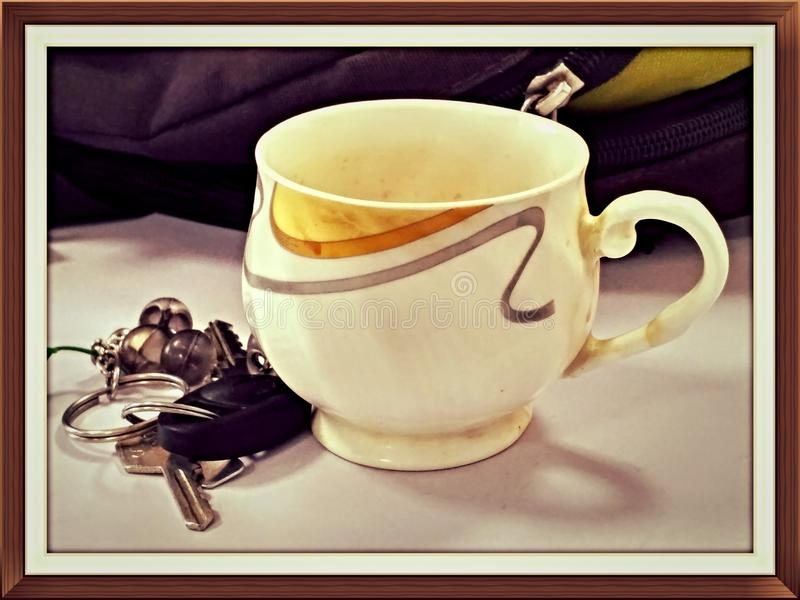 Herbaciana filiżanka & klucz fotografia royalty free
