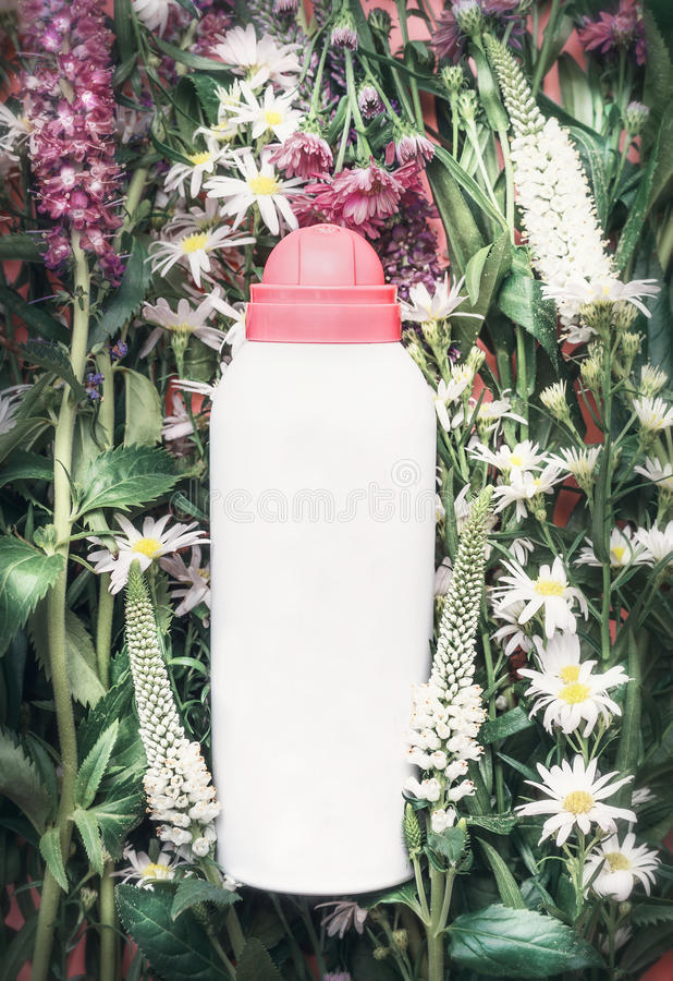Herbal cosmetic product bottle on herbs and flowers background , top view. Skincare , wellness, Natural cosmetic stock photography