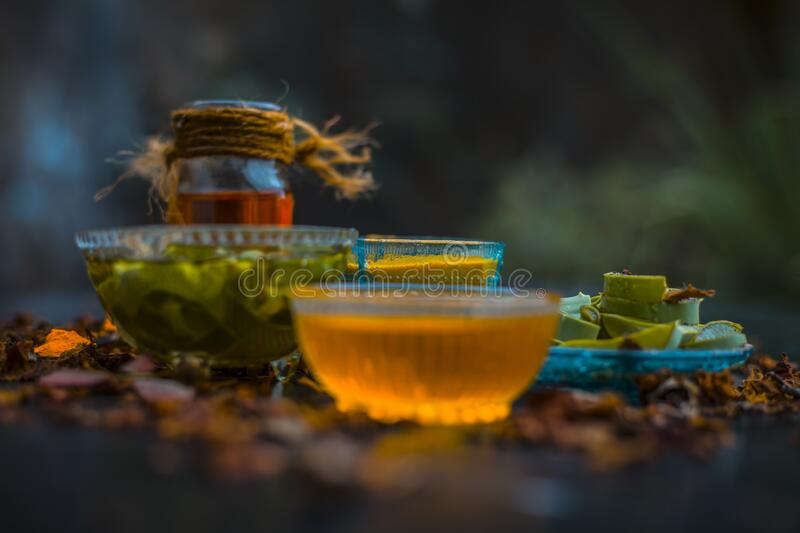 Herbal face pack of aloe vera ,turmeric,rose water, and honey for glowing and Radient skin and for all skin types all the ingredie. Nts on wooden surface,Close royalty free stock photo