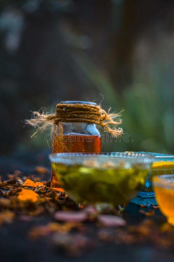 Herbal face pack of aloe vera ,turmeric,rose water, and honey for glowing and Radient skin and for all skin types all the ingredie. Nts on wooden surface,Close royalty free stock image