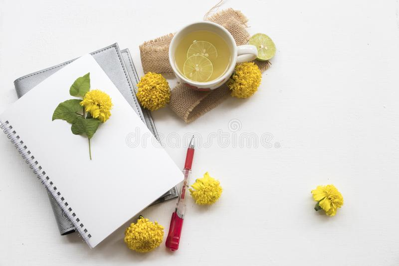 Herbal healthy drinks honey lemon cocktail water. With lemon slice ,leaf decoration flat lay style on background white wooden stock image