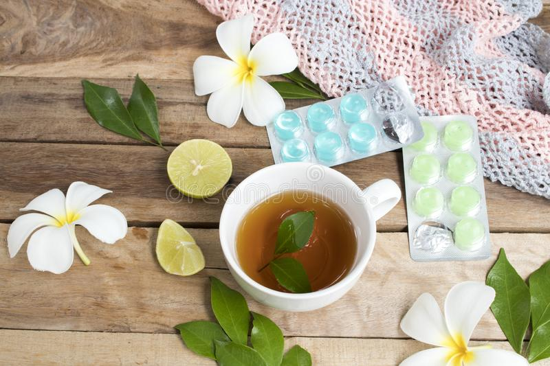 Herbal healthy drinks hot tea and lozenge for health care sore throat with knitting yarn ,teapot stock image