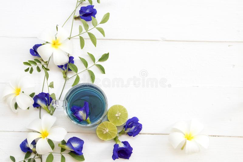 Herbal healthy drinks mix lemon with flower butterfly pea purple cold cocktail water. Herbal healthy drinks mix lemon with flower butterfly pea purple cocktail stock photo