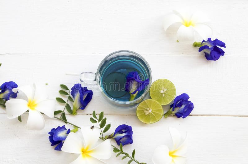 Herbal healthy drinks mix lemon with flower butterfly pea purple cold cocktail water. Herbal healthy drinks mix lemon with flower butterfly pea purple cocktail royalty free stock image