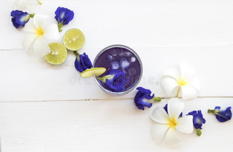 Herbal healthy drinks mix lemon with flower butterfly pea purple cold cocktail water. For health care local flora of asia arrangement flat lay style royalty free stock photo