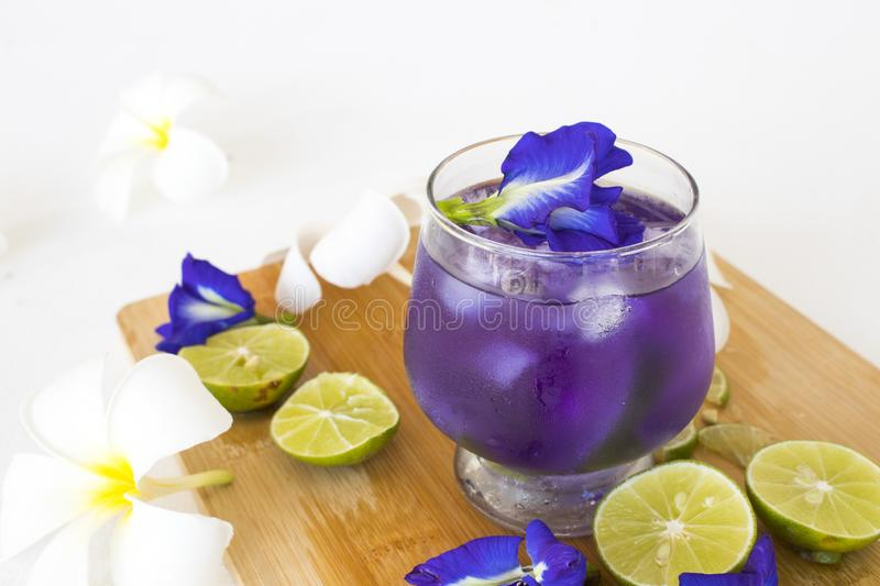 Herbal healthy drinks mix lemon with flower butterfly pea purple cold cocktail water. For health care local flora of asia arrangement flat lay style royalty free stock image