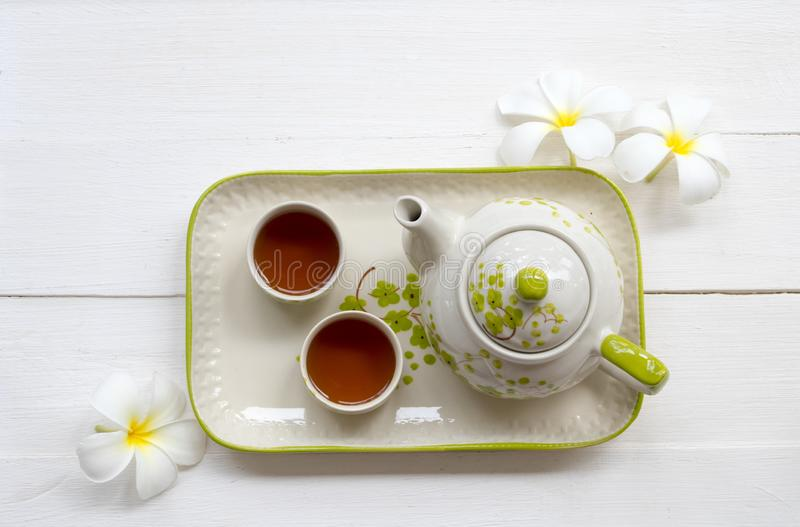 Herbal healthy drinks tea for health care sore throat with teapot ,flowers frangipani of lifestyle relax stock photography