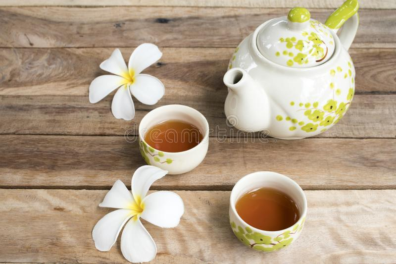 Herbal healthy drinks tea for health care sore throat with teapot ,flowers frangipani of lifestyle relax royalty free stock images