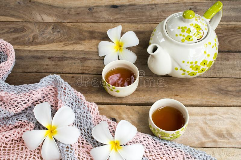 Herbal healthy drinks tea for health care sore throat with teapot ,flowers frangipani of lifestyle relax stock photos