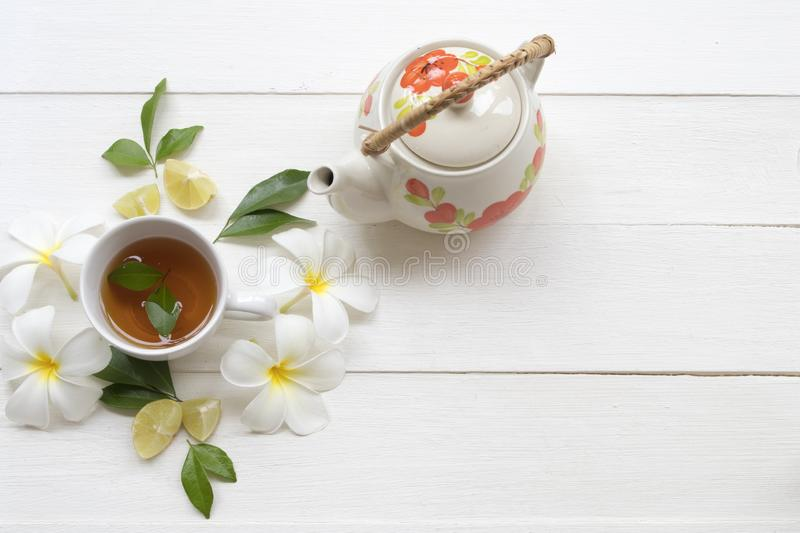 Herbal healthy drinks tea for health care sore throat with teapot ,flowers frangipani of lifestyle relax stock image