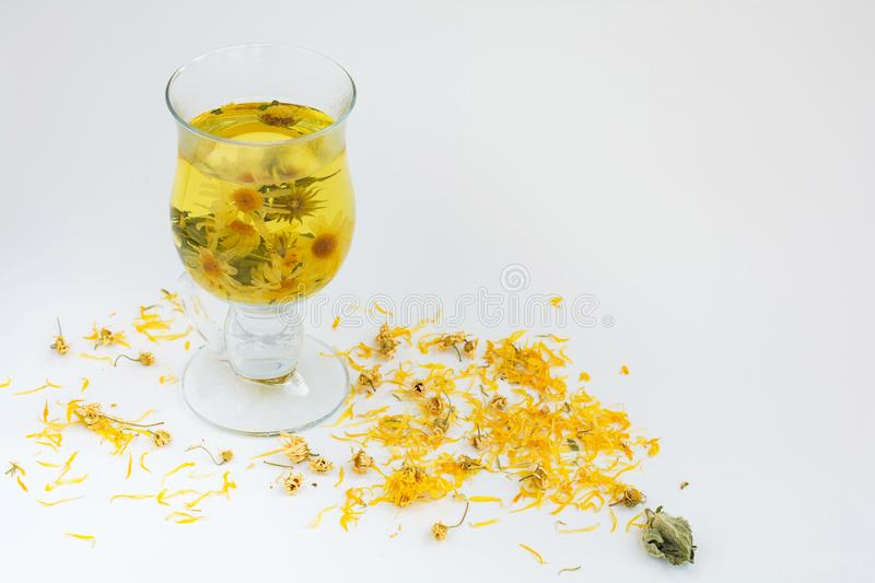 Herbal medicinal natural tea with chamomile, mint and calendula flowers royalty free stock photo