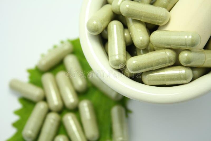 Herbal medicine capsules stock photos