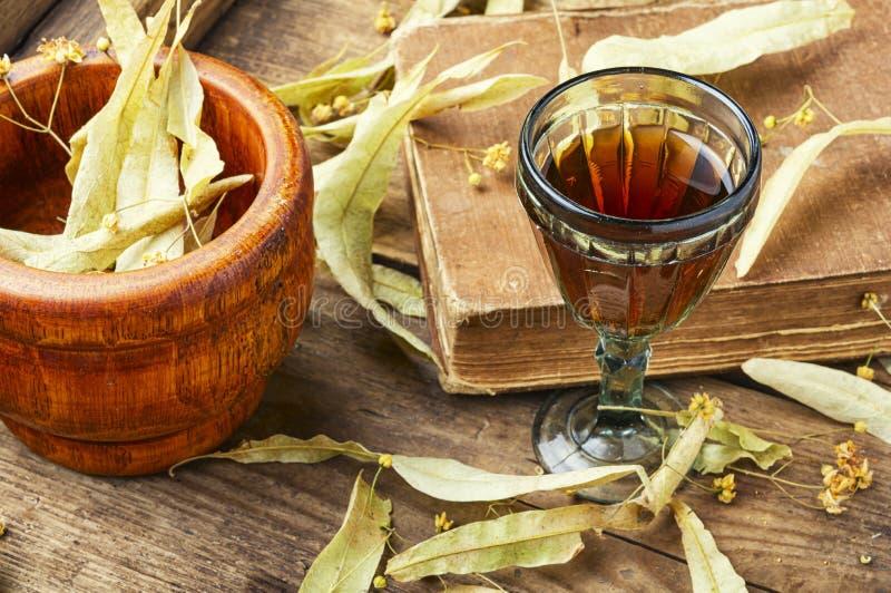 Healing tincture of linden. Herbal medicine.Healing tincture or decoction of linden flowers stock photography