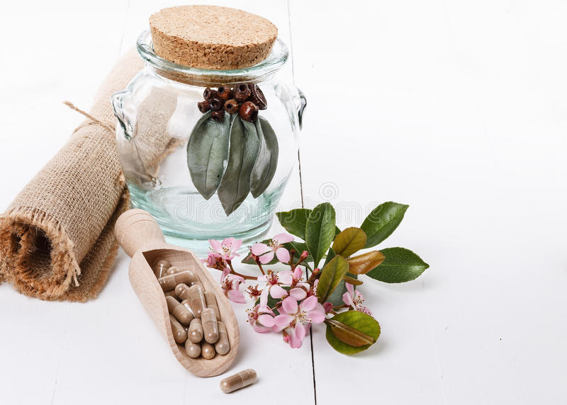Herbal medicine pills. And hawthorn over white background royalty free stock image