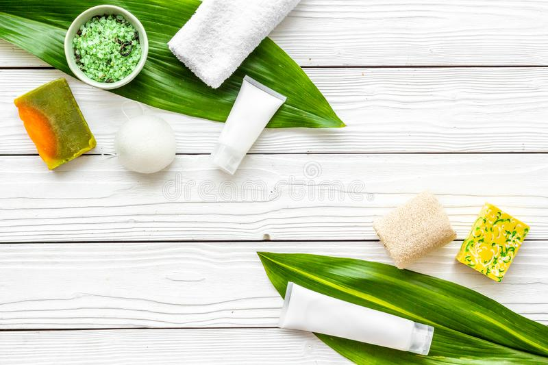 Herbal organic cosmetic set for homemade spa on white wooden background flatlay mock-up royalty free stock images