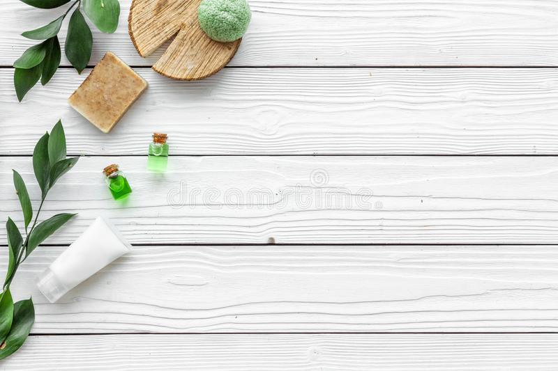 Herbal organic cosmetic set for homemade spa on white wooden background flatlay mock-up stock image