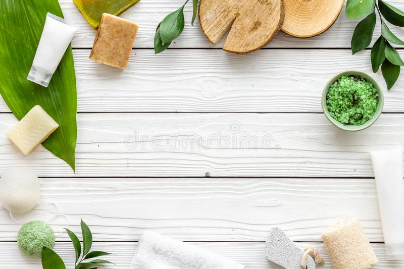 Herbal organic cosmetic set for homemade spa on white wooden background flatlay mock-up stock photography