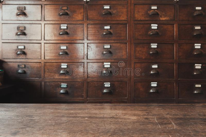 Herbal shop or Chinese herb store dried wooden antique cupboard. For medical drug storage royalty free stock photography