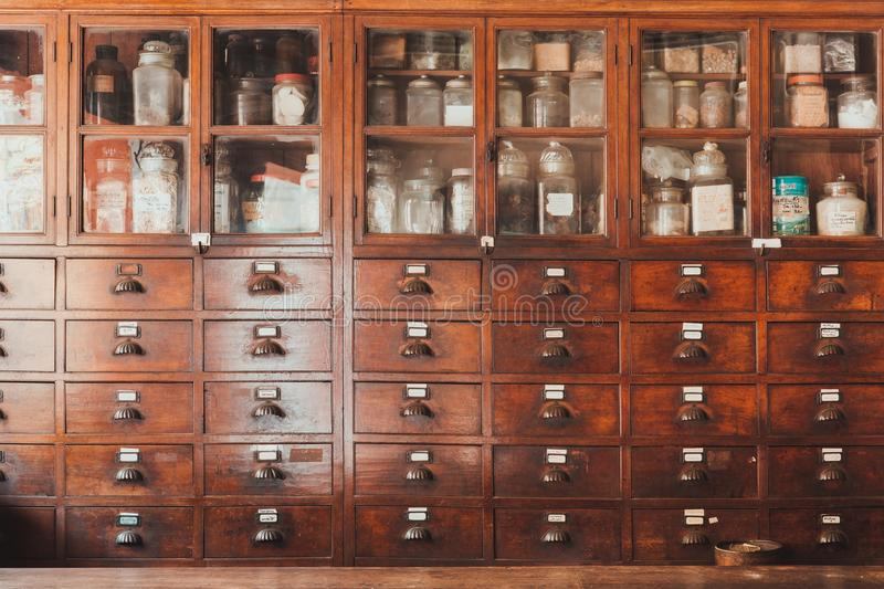 Herbal shop or Chinese herb store dried wooden antique cupboard. For medical drug storage stock photo