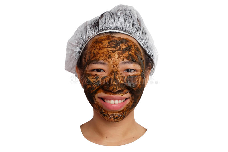 Herbal skin care. Woman getting facial mask isolated stock photos