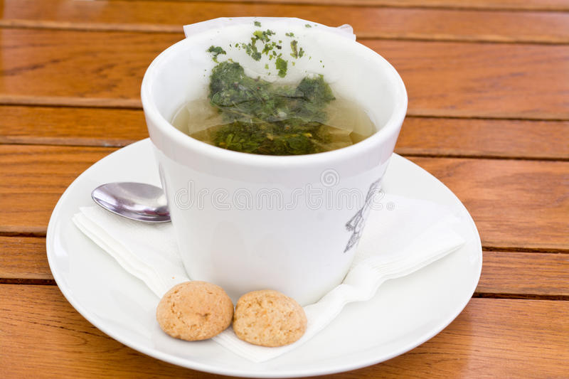 Herbal Tea Bag in cup stock images