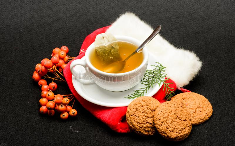 Herbal tea. Ceramic cup hot fresh brewed tea beverage. Health care folk remedies. Warm winter beverage. Cafe restaurant. Menu. Cup of tea on black background stock photography