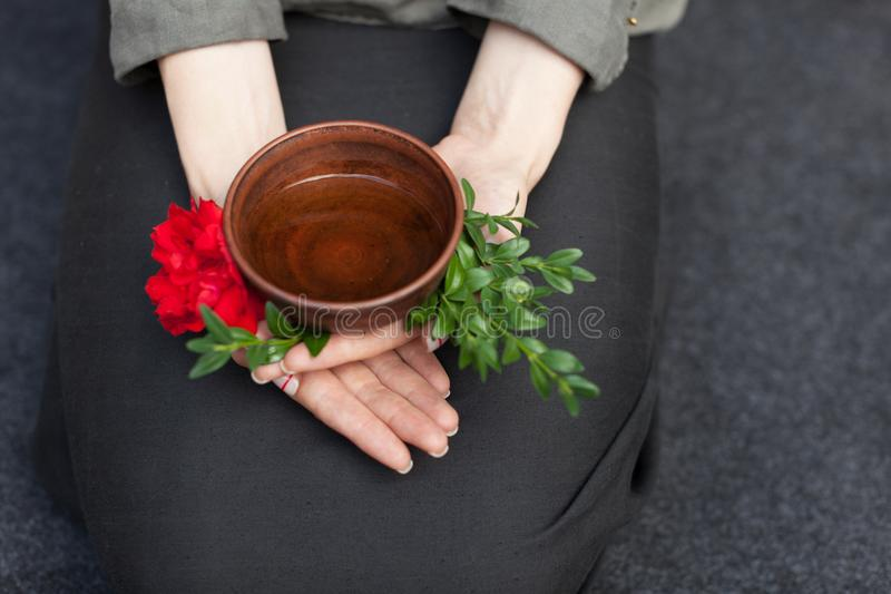 Herbal tea in a ceramic plate in female hands. The concept of nontraditional treatment of colds. Flu. Healthy Eating and Vitamins royalty free stock image
