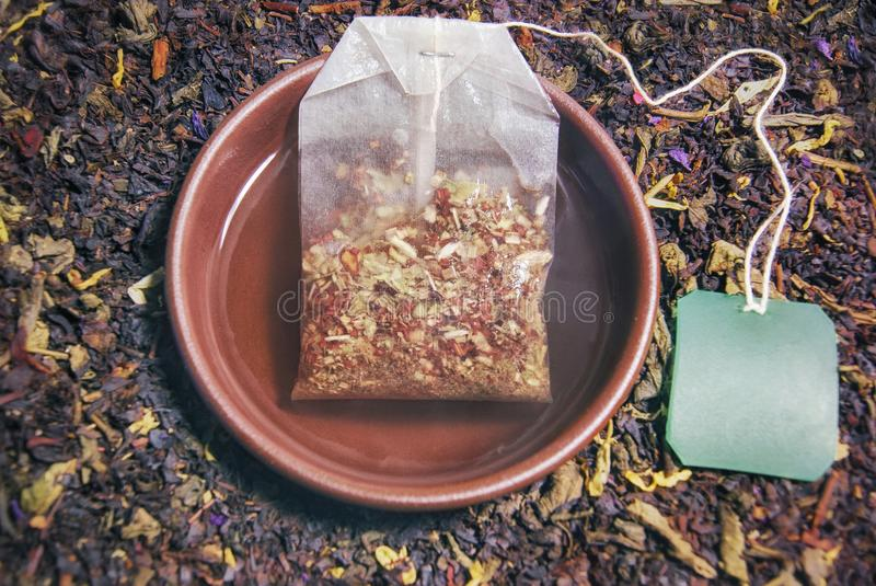 Herbal tea in a cup of brewed tea bag closeup composition and re royalty free stock photos