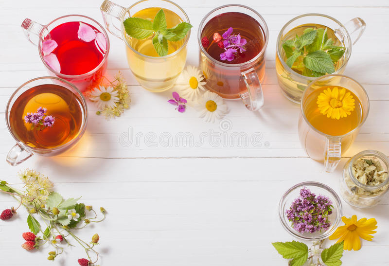 Herbal tea in cups on white background royalty free stock photography