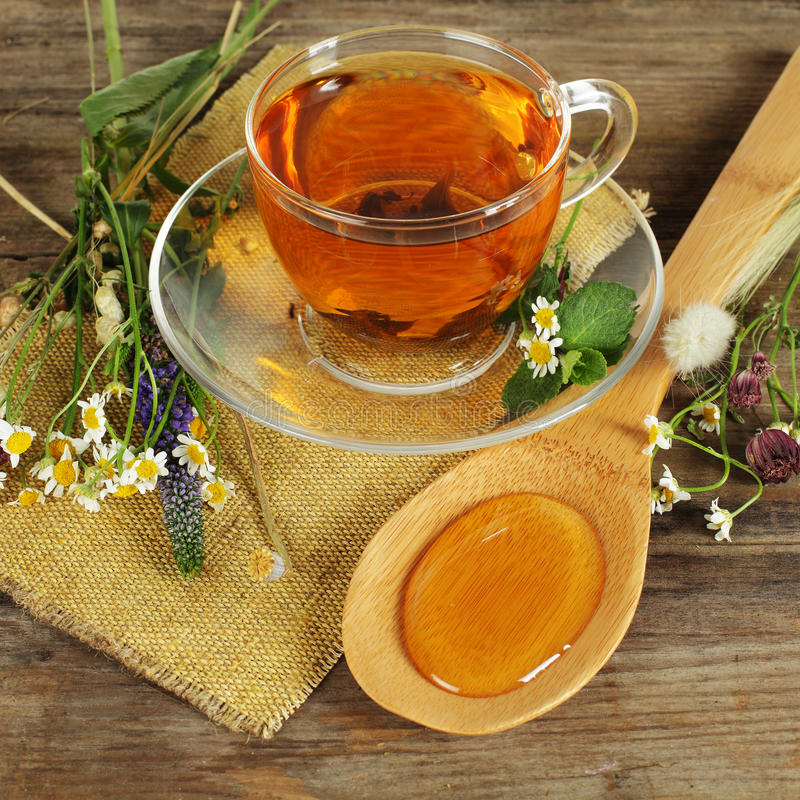 Herbal tea and honey. With wild flowers royalty free stock image