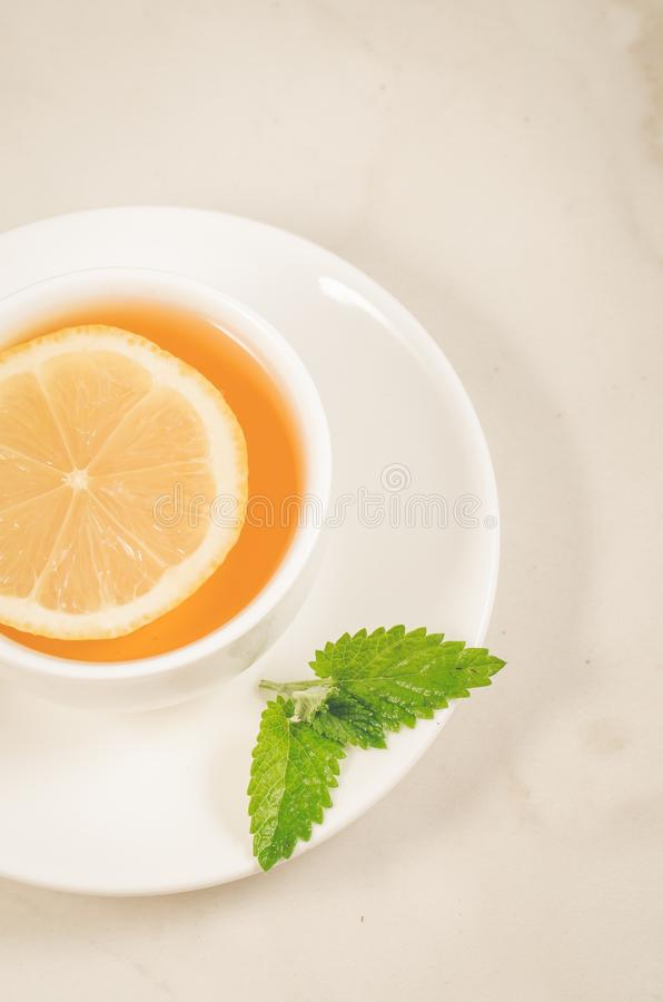 herbal tea with a lemon and mint/herbal tea with a lemon and mint on a white background closeup. Top view royalty free stock photography