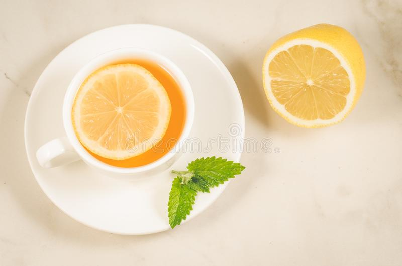 Herbal tea with a lemon and mint/herbal tea with a lemon and mint on a white background. Top view stock photos