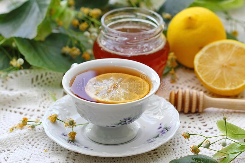 Herbal tea with linden flowers, honey and lemon stock image