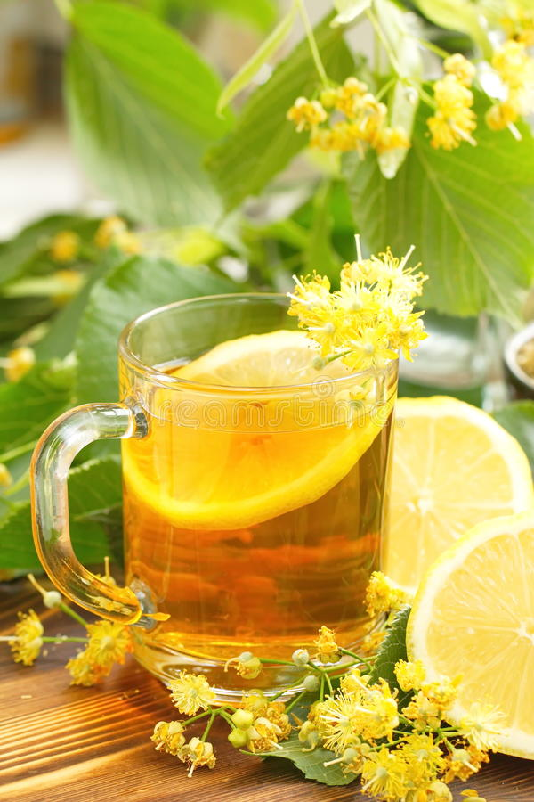 Herbal tea with linden flowers and lemon stock photos
